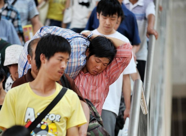 Passengers walk down stairs to board trains at Yinchuan Railway station.